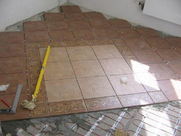 Укладка плитки в ванной комнате на полу