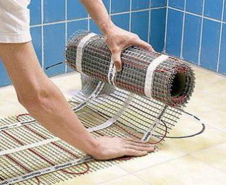 Укладка электрической системы подогрева пола под плитку